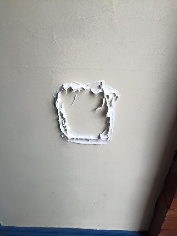 Scam letterbox glued to wall